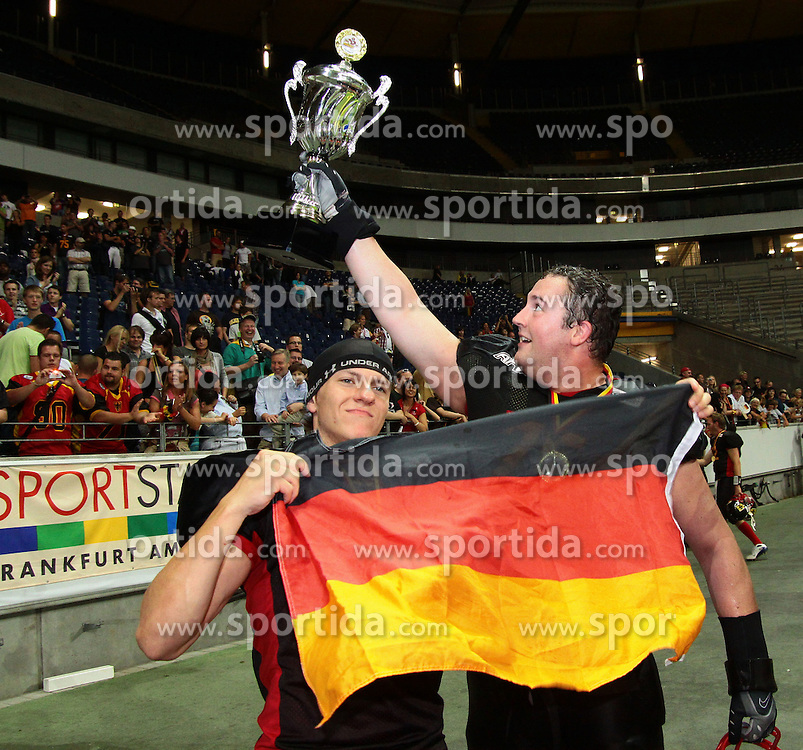 31.07.2010, Commerzbank Arena, Frankfurt, GER, Football EM 2010, Game for Place 1, Team France vs Team Germany, im Bild Jan Hilgenfeldt, (Team Germany, K, #35) und Marten Toewe, (Team Germany, OL, #75) mit dem Pokal fuer den EM Titel und einer deutschen Fahne,  EXPA Pictures © 2010, PhotoCredit: EXPA/ T. Haumer / SPORTIDA PHOTO AGENCY