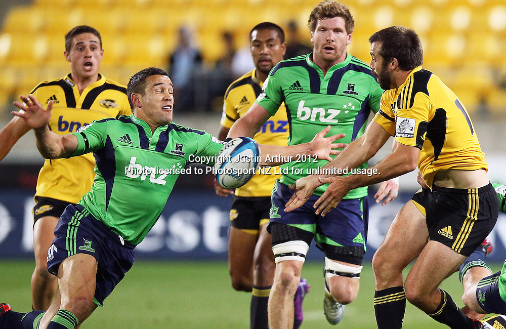 Highlanders' Tamati Ellison looks to tackle Hurricanes' Conrad Smith during the 2012 Super Rugby season, Hurricanes v Highlanders at Westpac Stadium, Wellington, New Zealand on Saturday 17 March 2012. Photo: Justin Arthur / Photosport.co.nz