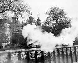 A salute of 41 guns crashes out from the Honourable Artillery Company's guns at the Tower of London, as King George VI and Queen Elizabeth leave Buckingham Palace.