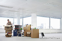 Woman with Cardboard Boxes in Empty Office Space
