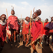 The Stars Foundation visiting S.A.F.E in the Loita Hills near the Tanzanian border in Kenya...It is mainly Maasais who live in the Loita Hills up above the Serengeti plains. They live in small villages and communities called bomas and live mainly of raising and selling live stock such as cattle and goats. Its a very remote region in Kenya, hard to get to without a four wheel drive with very little infrastructure and up till 2010 no mobile phone network. The Maasais are well known though out Kenya and the world for their colorful clothing and their way of keeping their old traditions alive...Young men called Morans are competing in jumping as high and straight as possible, a copetitive dance called adumu, at Wilson's wedding. The Morans are you men almost ready for the coming of age ceremony held every 10-15 years.