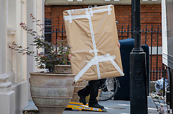 © Licensed to London News Pictures. 31/07/2018. London, UK. A large flat item is carried out of the official residence of the Foreign Secretary at Carlton Gardens in central London where former Foreign Secretary Boris Johnson has been living since his resignation. Photo credit: Rob Pinney/LNP