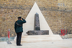 © Licensed to London News Pictures. 22/06/2017. London, UK. A serviceman salutes the African Caribbean Memorial as it is unveiled in Windrush Square in Brixton, south London, on Windrush Day. The memorial remembers the many African and Caribbean servicemen that fought in the Second World War. Photo credit: Rob Pinney/LNP