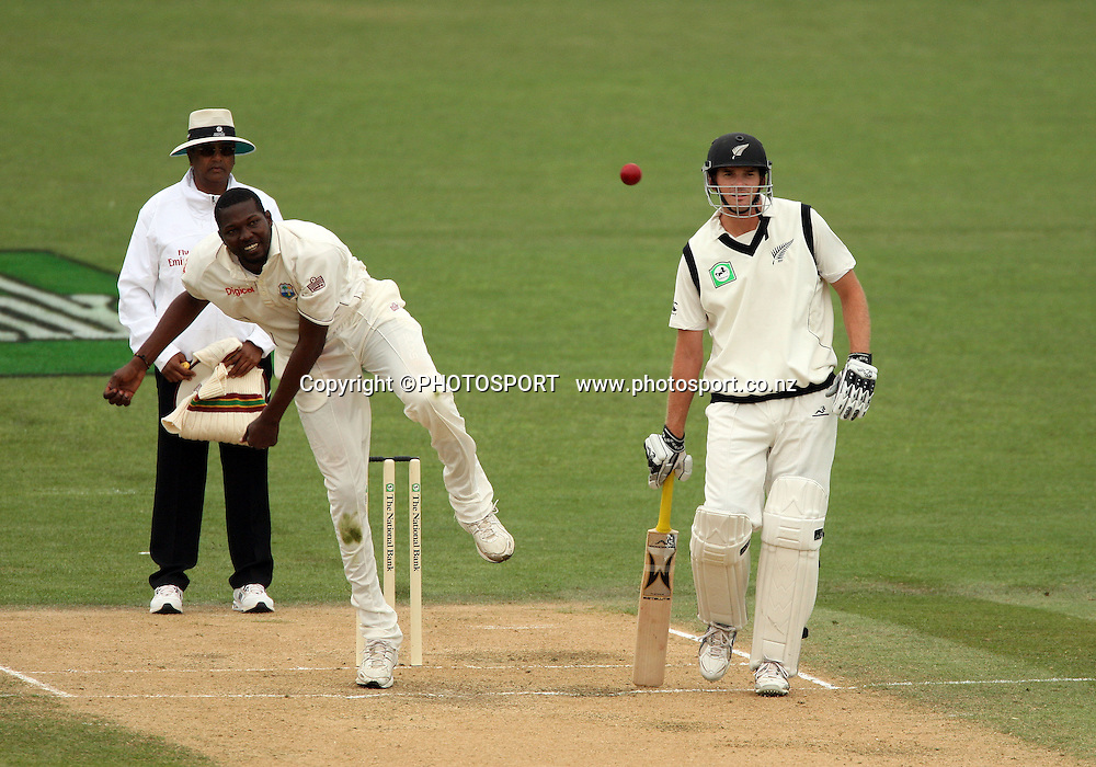 Sulieman Benn bowling as Kyle Mills looks on during play on day 3 of the second cricket test at McLean Park in Napier. National Bank Test Series, New Zealand v West Indies, Sunday 21 December 2008. Photo: Andrew Cornaga/PHOTOSPORT