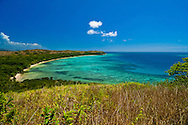Image taken standing on a rock, showing a beach hidden away on an island in Fiji.  Took several hours to reach the beach, with no trail or pathway, the region is covered in  just above  head height grasses. Nananui-i-ra Island. Fiji.