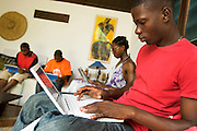 Students use laptops to browse the internet over a wireless network at the Kokrobitey Institute in the town of Kokrobitey, 30km west of Ghana's capital Accra on Sunday January 18, 2009. From left to right Reuben Sekpona, Abass Aryee, Nana Ama Bentsi-Enchill, Simon Mensah.