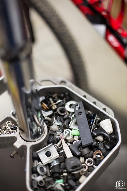 Peter Nguyen runs a new set of brake lines on a customer's mountain bike at Sun Bike Shop in Milpitas, Calif., on Sept. 18, 2012.  Nugyen has been a mechanic at Sun Bike Shop for 12 years.  Photo by Stan Olszewski/SOSKIphoto.