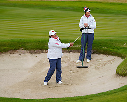 Auchterarder, Scotland, UK. 12 September 2019. Final practice day at 2019 Solheim Cup on Centenary Course at Gleneagles. Pictured; Nancy Lopez demonstrates a bunker shot under watchful gaze of Juli Inkster. Iain Masterton/Alamy Live News