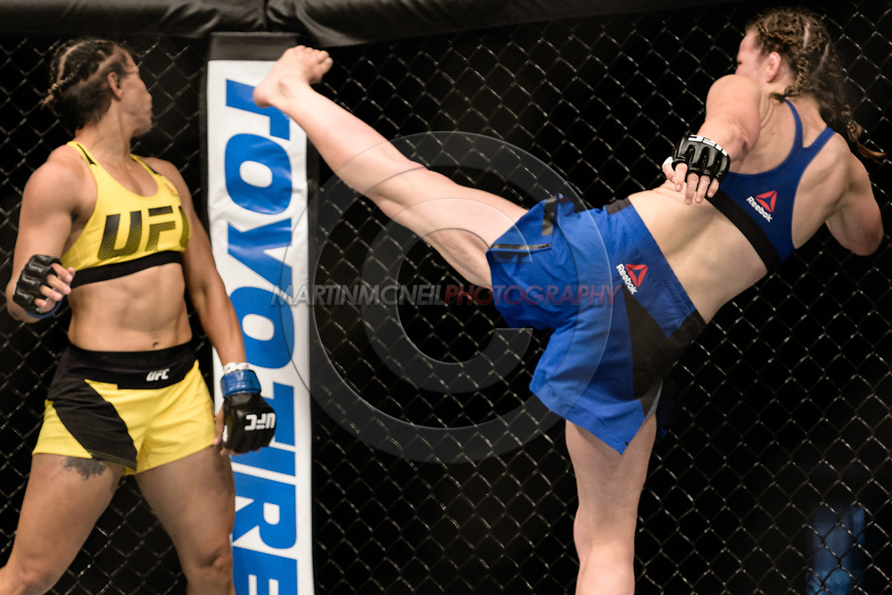 "GLASGOW, UNITED KINGDOM, JULY 16, 2017: Leslie Smith (blue shorts) versus Amanda Lemos (yellow shorts) during ""UFC Fight Night Glasgow: Nelson vs. Ponzinibbio"" inside the SSE Hydro Arena in Glasgow, Scotland on Sunday, July 16, 2017."