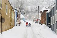 Family walking up 4th Street from Historic Main Street, Park City, Utah, USA.