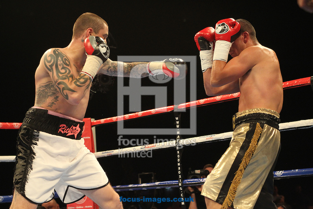 Ricky  Burns  (White/Black Shorts) and Alexandre Lepelley (Black/Gold) during their Light Welterweight bout at the First Direct Arena, Leeds<br /> Picture by Stephen Gaunt/Focus Images Ltd +447904 833202<br /> 04/10/2014