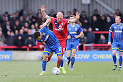 Andy Barcham of AFC Wimbledon and Russell Penn of York City FC tussle during the Sky Bet League 2 match between AFC Wimbledon and York City at the Cherry Red Records Stadium, Kingston, England on 19 March 2016. Photo by Stuart Butcher.