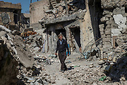 Kasim, 75, walks towards his house that was destroyed by an airstrike in the heavy fighting to liberate the Old City of Mosul last July. <br />