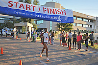 BELLVILLE, SOUTH AFRICA - Wednesday 3 December 2014, Fortunate Chidzivo crosses the line to take the ladies 2nd place during the Metropolitan 10km road race outside the Parc Du Cap head office in Bellville.<br /> Photo by IMAGE SA / Roger Sedres