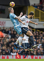 Football - 2016 / 2017 Premier League - Tottenham Hotspur vs. Stoke City<br /> <br /> Mousa Dembele of Tottenham and Glenn Whelan of Stoke City compete for the header at White Hart Lane.<br /> <br /> COLORSPORT/DANIEL BEARHAM