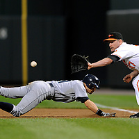 09 June 2009:  Seattle Mariners right fielder Ichiro Suzuki (51) dives back to first base as Baltimore Orioles first baseman Aubrey Huff takes the pickoff throw in the 3rd inning at Camden Yards in Baltimore, MD.  The Orioles defeated the Mariners 3-1.  ****For Editorial Use Only****