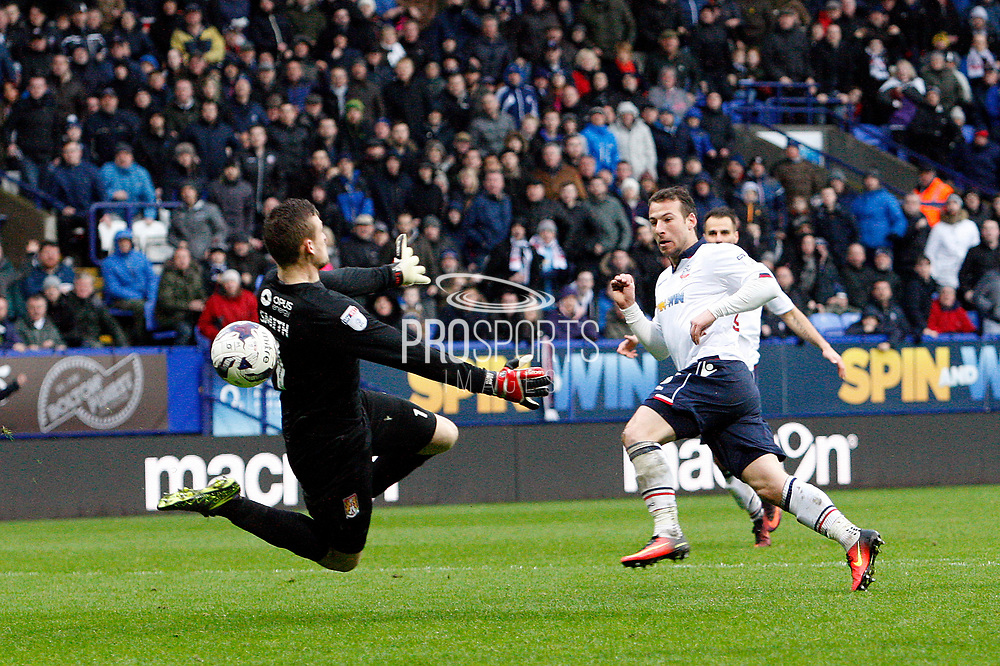 Northampton Towns keeper saves from a one on one from Bolton Wanderers Adam Le Fondre (45) during the EFL Sky Bet League 1 match between Bolton Wanderers and Northampton Town at the Macron Stadium, Bolton, England on 18 March 2017. Photo by Craig Galloway.