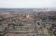 Nederland, Amsterdam, Oud-Zuid, 16-04-2008; Stadionbuurt gezien vanaf Minervalaan met rechtsonder Minervaplein; rechts - naar boven - de Stadionweg, van middenlinks met een boog naar het midden de Apollolaan, eindigend bij het witte gebouw van het Apollo-house (Apollohouse is het hoofdkantoor van het internationale advocatenkantoor Allen & Overy (voorheen Sociale Verzekeringsbank); op het tweede plan in het midden het Okurahotel, rechts de hoogbouw rond het Amstelstation (met de Rembrandt- Breitner- en Mondriaan-toren / tower); aan de horizon in de zon IJburg en het IJsselmeer..luchtfoto (toeslag); aerial photo (additional fee required); .foto Siebe Swart / photo Siebe Swart