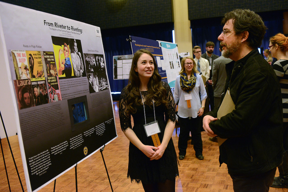 A student participating in the Undergraduate Research Symposium presents her research to a professor during the 2015 event. Undergraduate research has become an integral part of the Kent State experience.