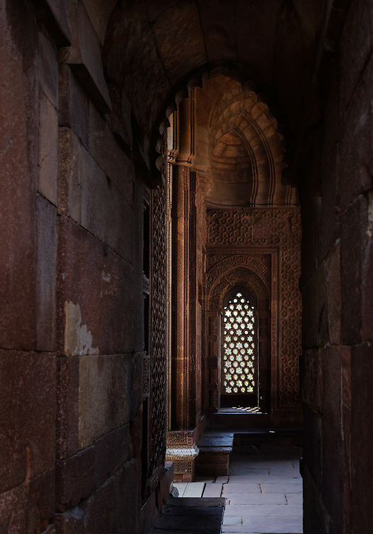 NEW DELHI, INDIA - CIRCA OCTOBER 2016: Carved arches inscriptions and window in the Alai Darwaza Mosque of the Qutb Minar Complex. The complex features is an array of monuments and buildings at Mehrauli in Delhi, India. An Unesco World Heritage Site and popular touriest attraction in Delhi.
