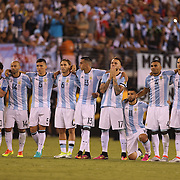 EAST RUTHERFORD, NEW JERSEY - JUNE 26:  The Argentinian team on the half way line watching the final penalty kick of the penalty shoot out which gave Chile victory during the Argentina Vs Chile Final match of the Copa America Centenario USA 2016 Tournament at MetLife Stadium on June 26, 2016 in East Rutherford, New Jersey. (Photo by Tim Clayton/Corbis via Getty Images)