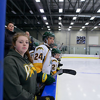 1st year forward Merissa Zerr (24) of the Regina Cougars looks on from the bench during the Women's Hockey Home Game on October 14 at Co-operators arena. Credit: Arthur Ward/Arthur Images