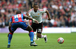 Luis Antonio Valencia of Manchester United takes on Yannick Bolasie of Crystal Palace - Mandatory by-line: Robbie Stephenson/JMP - 21/05/2016 - FOOTBALL - Wembley Stadium - London, England - Crystal Palace v Manchester United - The Emirates FA Cup Final