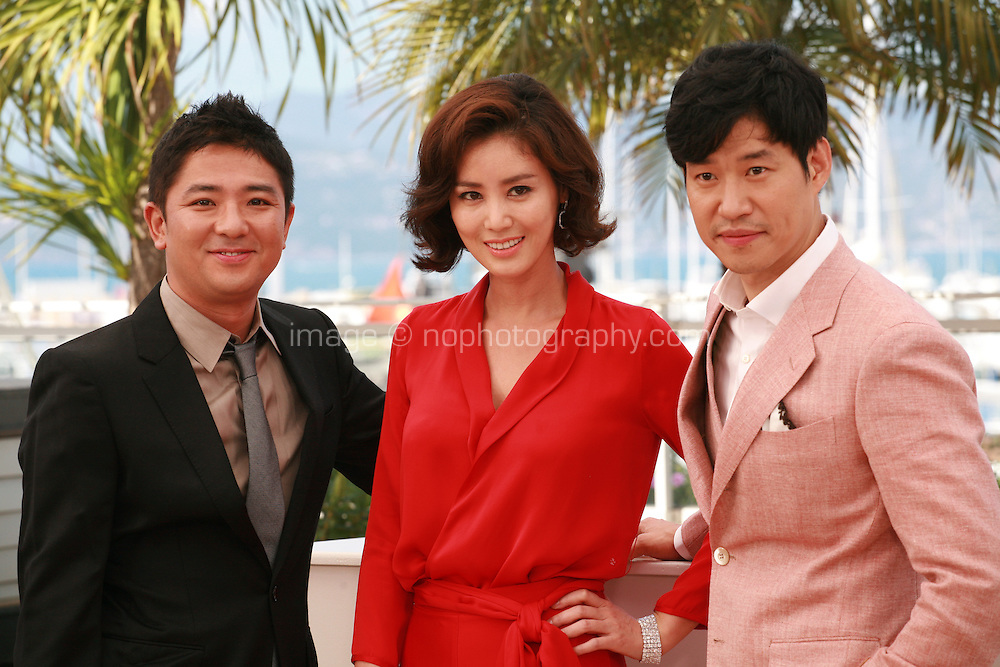 Director Chang, Actress Kim Sun-Ryoung and Actor Yu Jun-Sang at the photo call for the film The Target at the 67th Cannes Film Festival, Friday 23rd May 2014, Cannes, France.