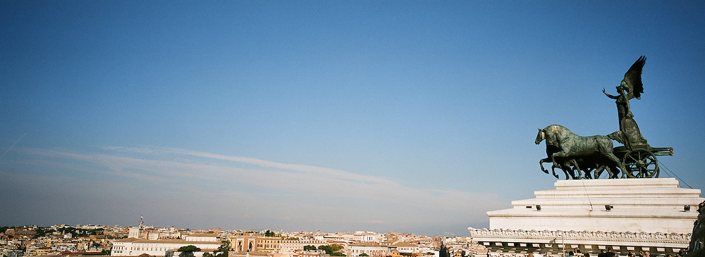 The statue of the goddess Victoria riding on quadrigas, overlooking Rome on top of the Emmanuel Monument. The Monumento Nazionale a Vittorio Emanuele II (National Monument to Victor Emmanuel II) or Altare della Patria.  Rome, Italy. 23rd July 2011. Photo Tim Clayton