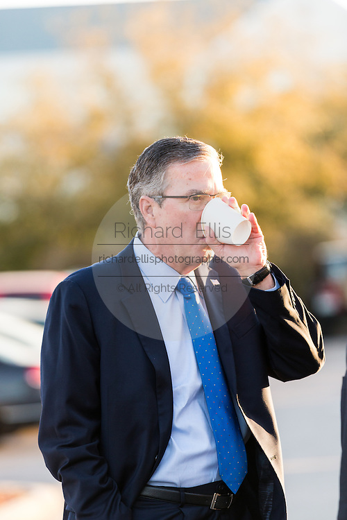 Former Florida Governor and potential Republican presidential candidate Jeb Bush has a coffee before an early morning GOP breakfast event with his aides March 18, 2015 in Myrtle Beach, South Carolina.