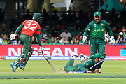 Mosaddek Hossain of Bangladesh survives a run out attempt by Shadab Khan of Pakistan who splatters the stumps as he slides in to them during the ICC Cricket World Cup 2019 match between Pakistan and Bangladesh at Lord's Cricket Ground, St John's Wood, United Kingdom on 5 July 2019.