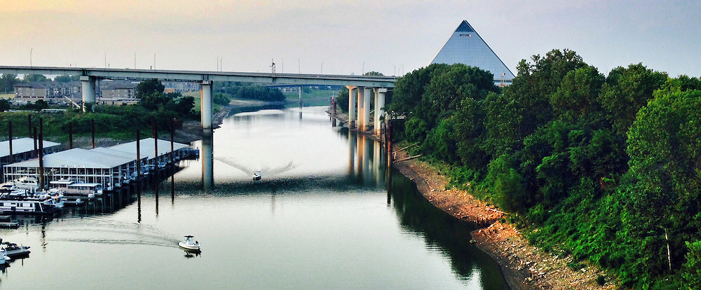 The Pyramid in Memphis is currently being renovated by Bass Pro Shop.  Bass Pro Shops at the Pyramid is set to open in spring 2015. In addition to vast assortments of outdoor gear, the new mega store will include a grand hotel, 600,000 gallons of water features; a cypress swamp with 100-foot-tall trees; an interactive National Waterfowling Heritage Center by Ducks Unlimited; and a glass-floored cantilevering observation deck at the top of the 32-story steel pyramid. It sits on the Wolf River just off the Mississippi River.