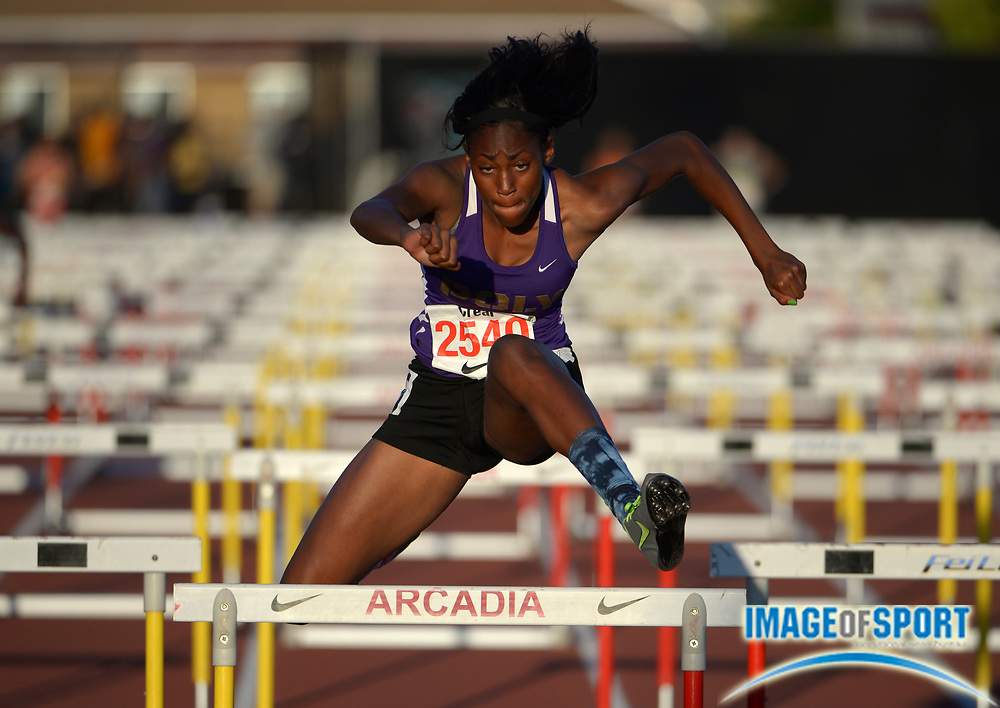 Apr 11, 2014; Arcadia, CA, USA; Ebony Crear runs a leg on the Long Beach Poly girls 4 x 100m shuttle hurdles relay that placed second in 58.05 in the 47th Arcadia Invitational at Arcadia High.