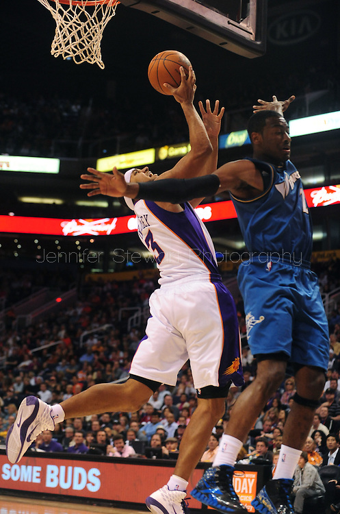 Dec. 5 2010; Phoenix, AZ, USA; Phoenix Suns forward Jared Dudley (3) puts up a basket during the second half against Washington Wizards guard John Wall (2) at the US Airways Center. The Suns defeated the Wizards 125-108. Mandatory Credit: Jennifer Stewart-US PRESSWIRE.