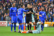 Victor Camarasa (21) of Cardiff City protests to referee Craig Pawson after Kenneth Zohore (10) of Cardiff City with a clear goal scoring chance was deliberately fouled by Antonio Rudiger (2) of Chelsea but the Chelsea player only received a yellow card which Cardiff players believed should have been a red card during the Premier League match between Cardiff City and Chelsea at the Cardiff City Stadium, Cardiff, Wales on 31 March 2019.