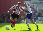 Nationwide Div 2 Brentford v Hartlepool..Brentford's Ben May attacking down the wing is tackled by Hartlepools Michael Nelson.