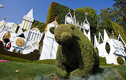 Bear shaped bush landscaping on It's a Small World ride and attraction, Disneyland Resort, Anaheim, California, United States of America.