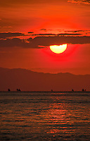Fishing boats sihlouetted against the rising sun off Amed, Bali, Indonesia