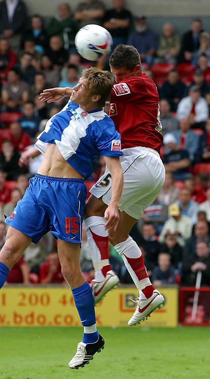 Photo: Dave Linney.<br />Walsall v Hartlepool United. Coca Cola League 2. 12/08/2006Walsall's .Kris Taylor(R) beats Anthony Sweeney to the ball.