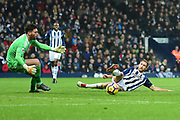 West Bromwich Albion defender Gareth McAuley (23) slides in to clear in front of West Bromwich Albion goalkeeper Ben Foster (1) during the Premier League match between West Bromwich Albion and Southampton at The Hawthorns, West Bromwich, England on 3 February 2018. Picture by Dennis Goodwin.