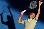 Roger Federer serves during the Brisbane International 2014 at the Queensland Tennis Centre on Thursday January 2nd, 2014 in Brisbane, Queensland, Australia. (Photo: Matt Roberts/mattrimages.com.au for Brisbane International)
