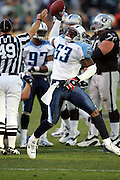 OAKLAND, CA - DECEMBER 19:  Linebacker Keith Bulluck #53 of the Tennessee Titans spikes the ball in celebration after recovering a fumble late in the game against the Oakland Raiders at Network Associates Coliseum on December 19, 2004 in Oakland, California. The Raiders defeated the Titans 40-35. ©Paul Anthony Spinelli *** Local Caption *** Keith Bulluck