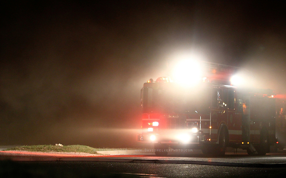 07 September 2010: A fire truck illuminates the plumes of smoke coming from the Atomic Fireworks building near the intersection of West Bypass and Sunshine. The fire started early Tuesday morning and currently, the cause of the fire is unknown. Credit: David Welker / TurfImages.com