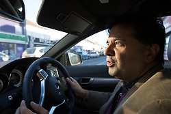 Image ©Licensed to i-Images Picture Agency. 07/03/2015. London, United Kingdom. Ravi Bhanot and family, Conservative Party supporters in Ilford. Ravi Bhanot drives his car to his Hindu Temple for a social event. Ilford. Picture by Daniel Leal-Olivas / i-Images