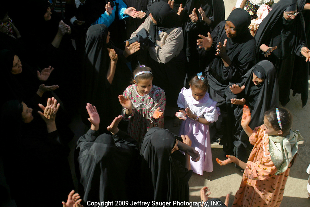 The Al-Kasid women celebrate during the family's homecoming in the village Suq ash Shuyukh on the outskirts of Nasiriyah, Iraq, July 30, 2003. The celebration lasts three days with different tribal chiefs, family members and friends coming and going. ..The Al-Kasid family fled Iraq after the Gulf War and their part in the uprising against Saddam Hussein in 1991, spent 3 years in Rafa, Saudi Arabia and finally settled in Dearborn, MI. The family hasn't been home to Iraq in 13 years.