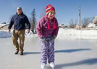 Thor Sliker watches as his daughter Libby takes to the ice at Memorial Park during Laconia Parks and Recreation Skating Party Friday afternoon.  (Karen Bobotas/for the Laconia Daily Sun)