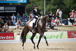Katinaite-Pranckeviciene Dalia, (LTU), Furs Frederik<br /> First Qualifying Competition 5year old horses<br /> World Championship Young Dressage Horses - Verden 2015<br /> © Hippo Foto - Dirk Caremans<br /> 06/08/15