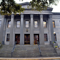 United States Custom House in Savannah, Georgia<br /> When this United States Custom House was finished in 1852, it was third building to have that role since the first one opened in 1789. This custom house also served as a post office and federal courthouse. The Greek Revival façade was designed by John S. Norris. He was a prolific architect in the city during the mid-1800s. Norris is credited with over a dozen Savannah landmarks. From 1861 until 1864, this historic structure was under Confederate control during the Civil War. Look closely at the top of the six enormous columns. You will see the capitals are etched with a tobacco leaf design.