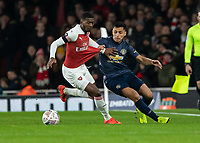 Football - 2018 / 2019 FA Cup - Fourth Round: Arsenal vs. Manchester United <br /> <br /> Ainsley Maitland-Niles (Arsenal FC) and Alexis Sanchez (Manchester United) compete for the loose ball at The Emirates Stadium.<br /> <br /> COLORSPORT/DANIEL BEARHAM