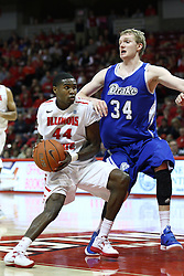 12 January 2013:  Johnny Hill heads for the paint against defender Ben Simons during an NCAA Missouri Valley Conference mens basketball game Where the Bulldogs of Drake University beat the Illinois State Redbirds 82-77 in Redbird Arena, Normal IL